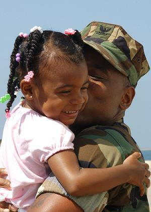 U.S. Navy Officer hugging his daughter
