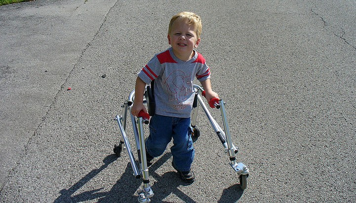 Child using reverse walker