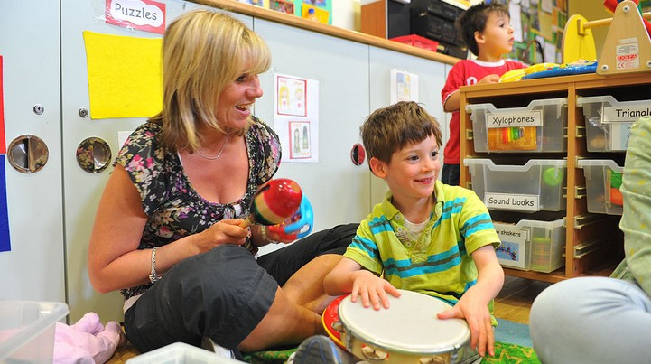Child and adult playing with musical instruments