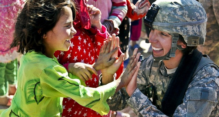 Soldier giving girl high 5