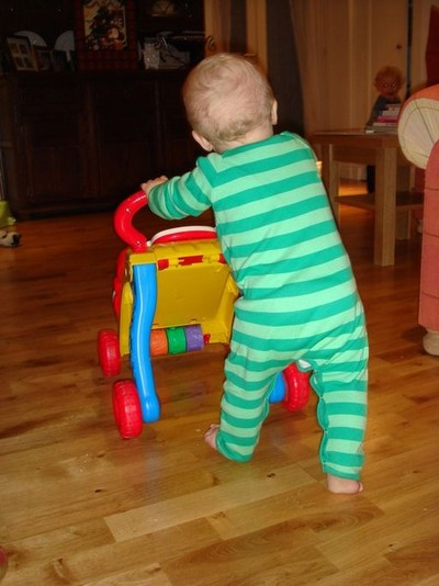 Toddler with push toy