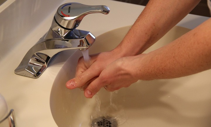 adult washing hands