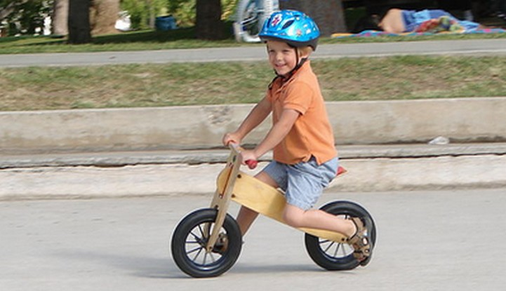 Boy on wooden balance bike