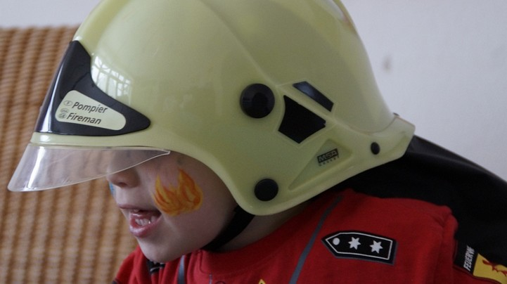 Boy wearing play helmet