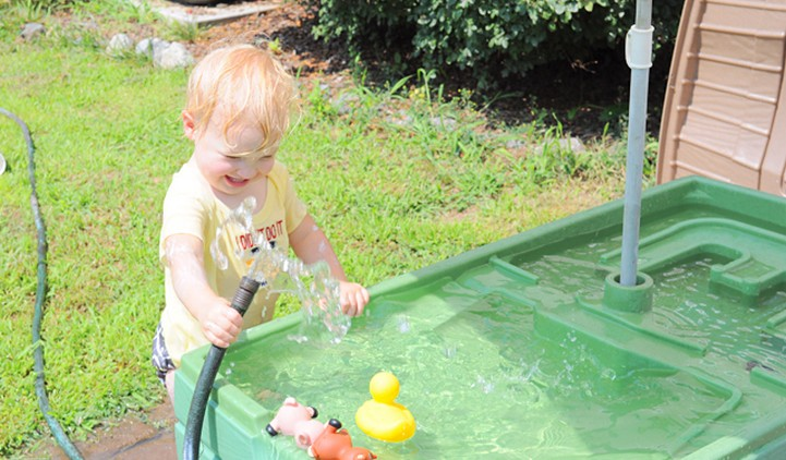 Child playing at water table
