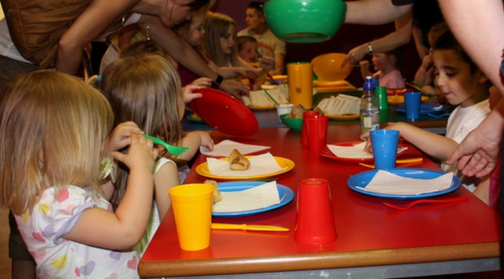 Children eating at red table