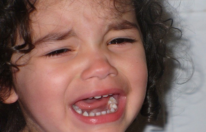 Girl with curly hair crying