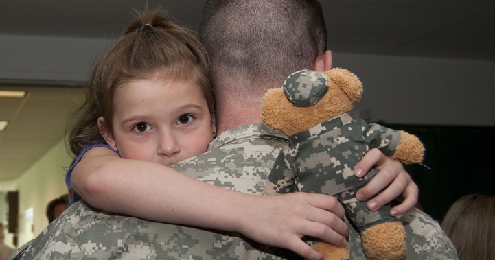 Girl hugging military dad