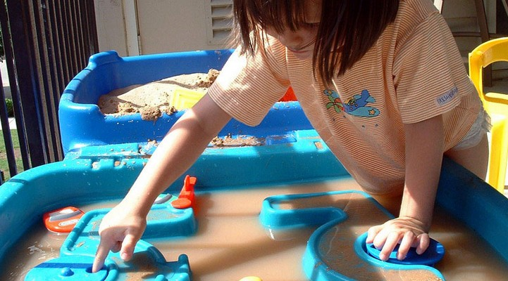 Girl playing at water table