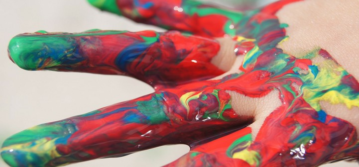 Hand covered with colorful paint