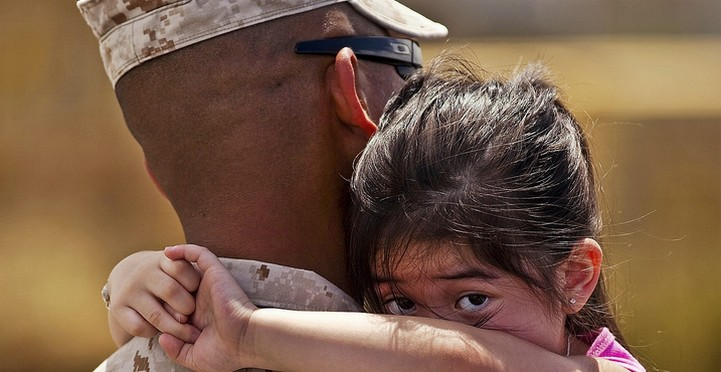 Service member comforting child