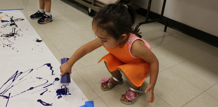 Toddler painting with squeeze bottle