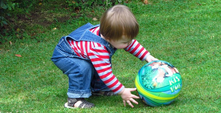 Toddler rolling ball